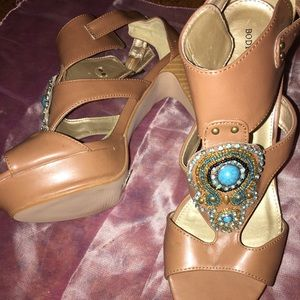 Body central brown pumps